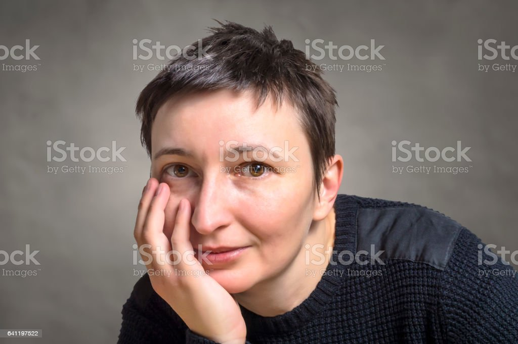 Portrait of smiling young adult woman. stock photo
