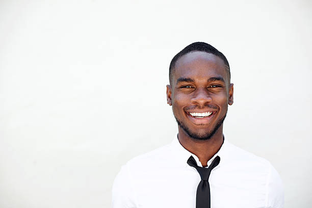 Portrait of smiling young african businessman stock photo