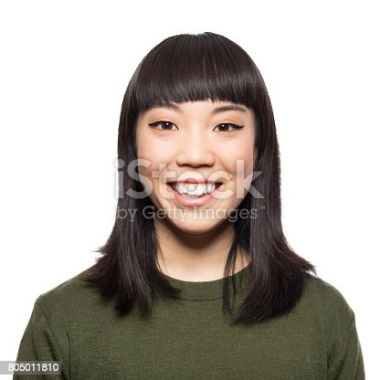 istock Portrait of smiling young asian woman 805011810