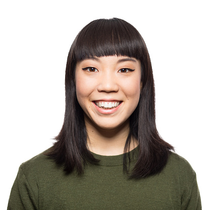 Portrait of smiling young asian woman standing on white background