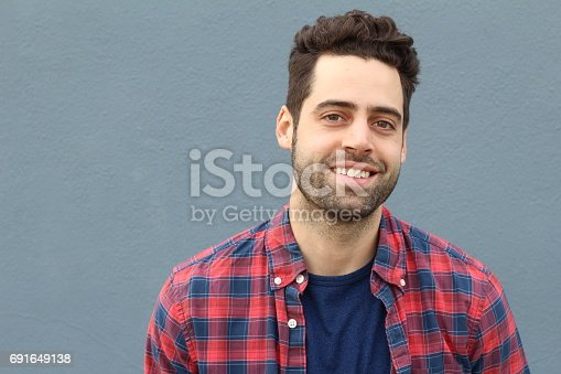istock Portrait of smiling young bearded man 691649138