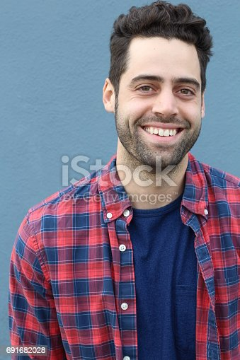 istock Portrait of smiling young bearded man 691682028