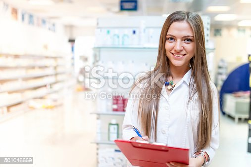 istock portrait of smiling young blonde pharmacist at drug store 501046669