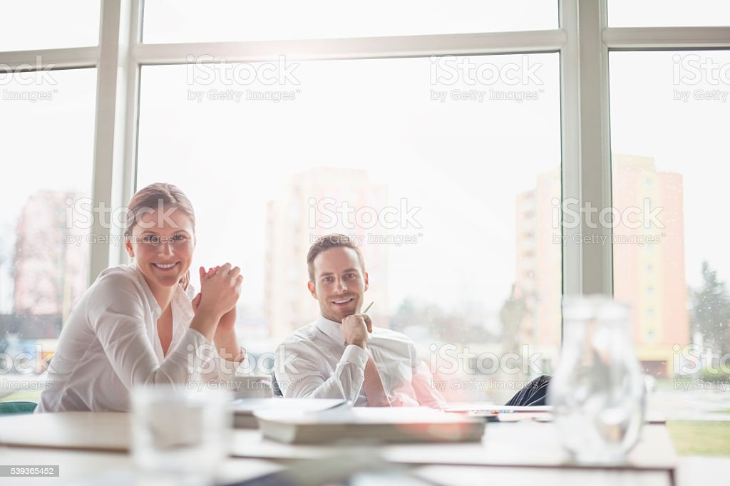 Portrait of smiling young business people in meeting room stock photo