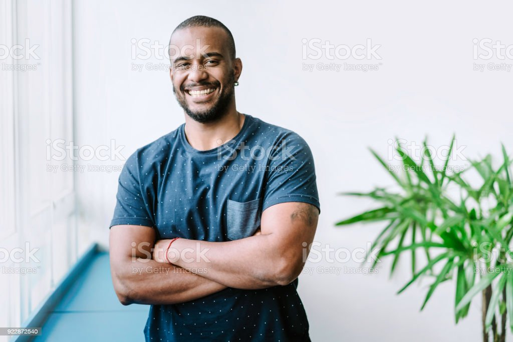 Portrait of smiling young businessman in creative office stock photo