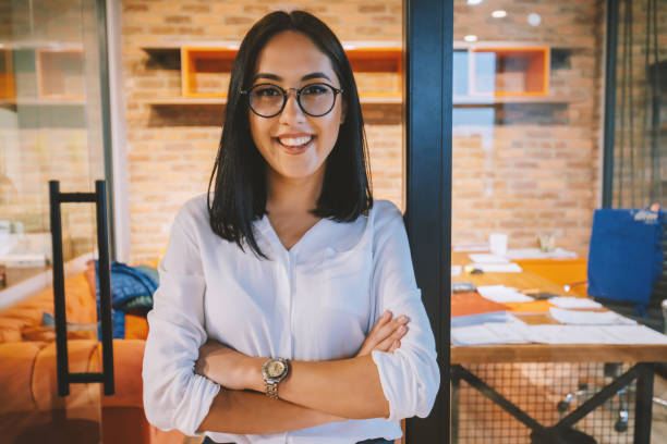Portrait of smiling young businesswoman in office stock photo