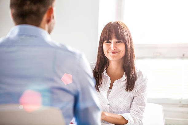 Portrait of smiling young businesswoman with male colleague in office – Foto