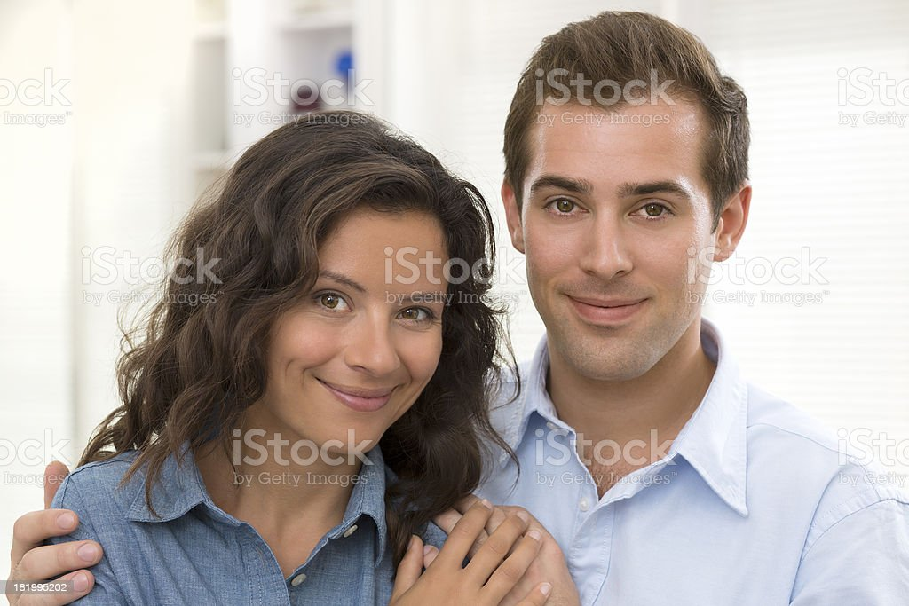 Portrait of smiling young couple at home royalty-free stock photo