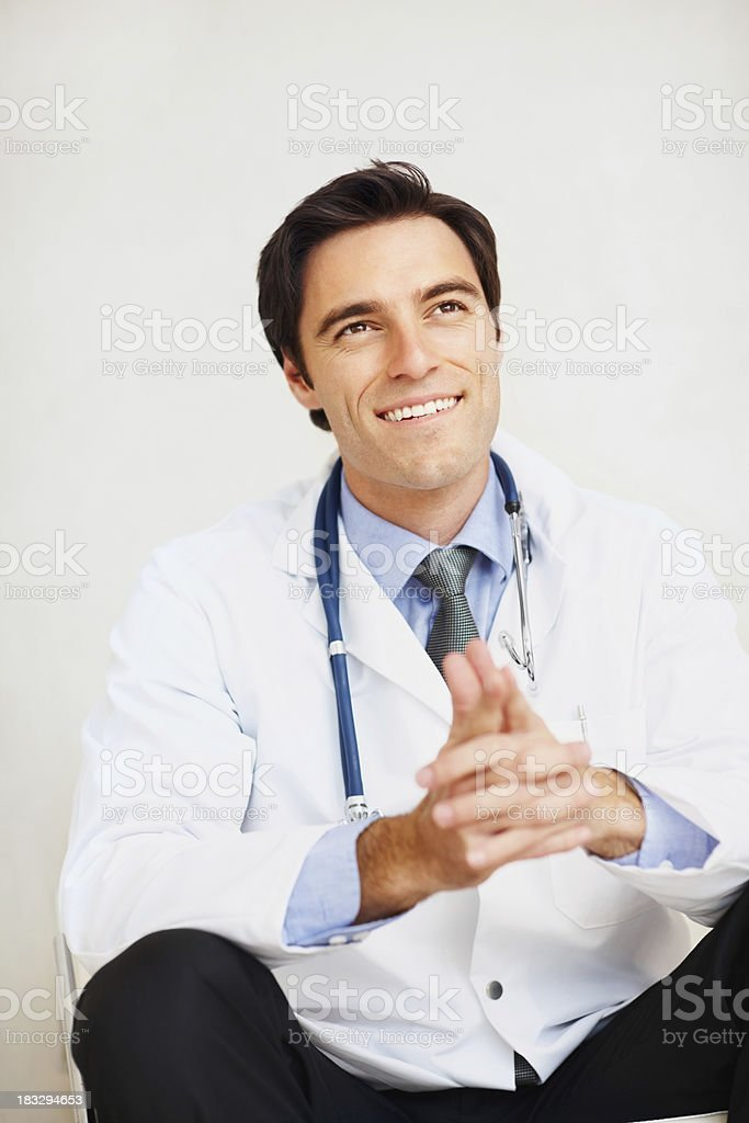 Portrait of smiling young doctor with a stethoscope royalty-free stock photo