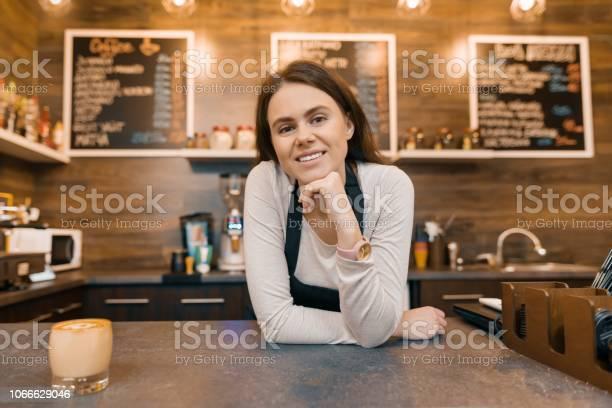 Portrait of smiling young female coffee shop owner confident woman picture id1066629046?b=1&k=6&m=1066629046&s=612x612&h=5 9d9o3q1qmfmhgdo15ejakze0rekgcu5shq5g  i k=