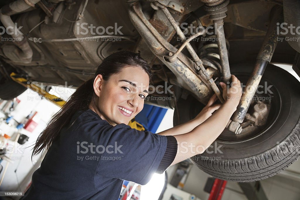 Portrait of smiling young female mechanic stock photo