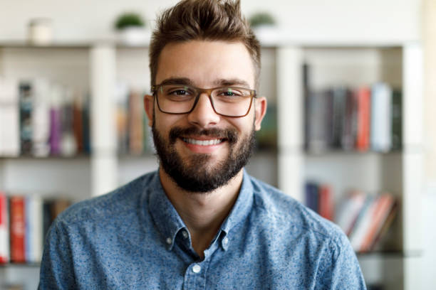 Portrait of smiling young man at home office stock photo