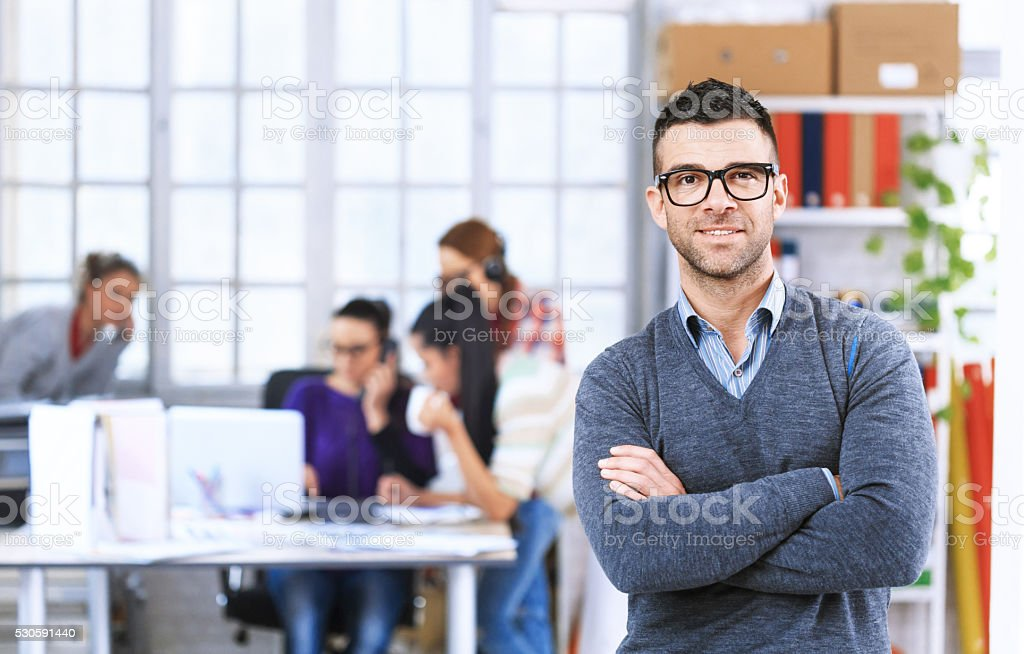 Portrait of smiling young man at the office stock photo