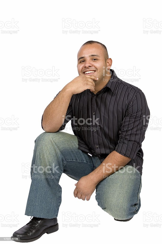 Portrait of smiling young man crouching royalty-free stock photo