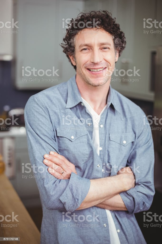Portrait of smiling young man in kitchen stock photo