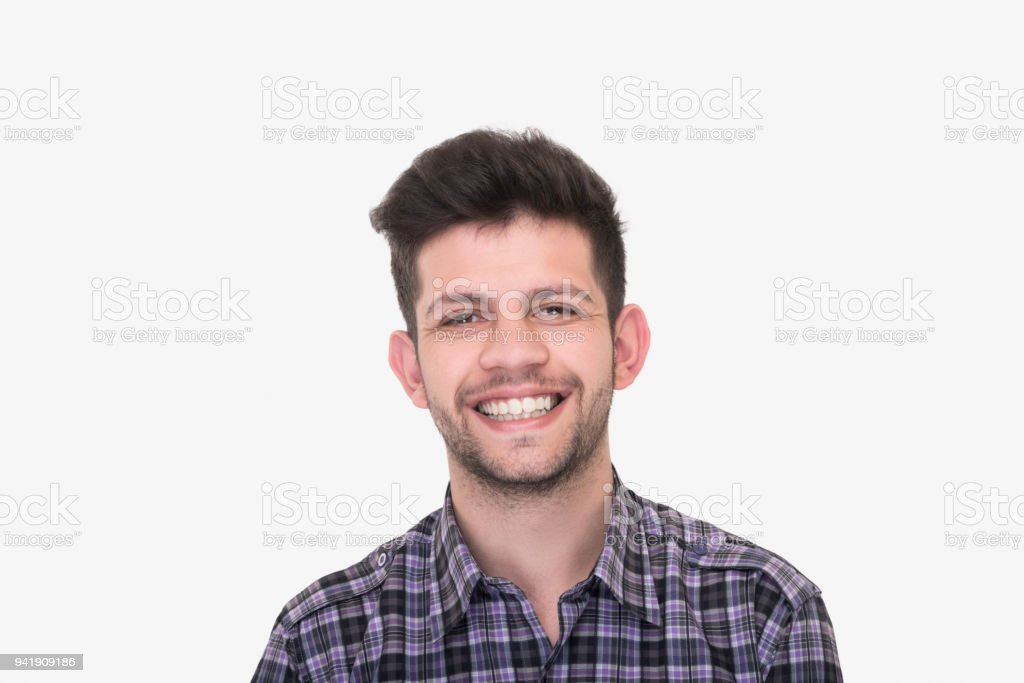 Portrait of smiling young man looking at camera on white background stock photo