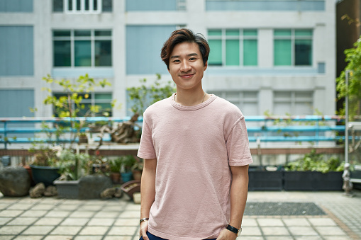 Portrait of smiling young man on terrace in city