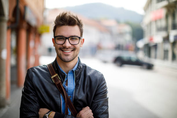 Portrait of smiling young man outdoor stock photo