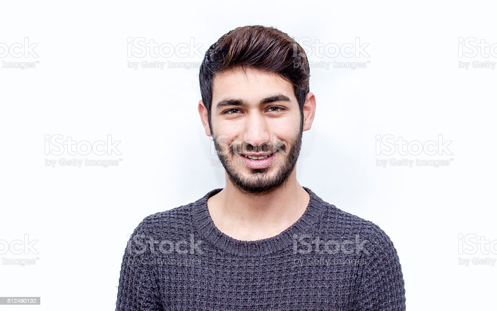 Portrait of smiling young man over white background stock photo