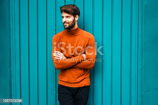 istock Portrait of smiling young man. 1057013256
