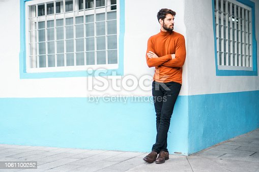 istock Portrait of smiling young man. 1061100252