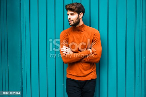 istock Portrait of smiling young man. 1061102044