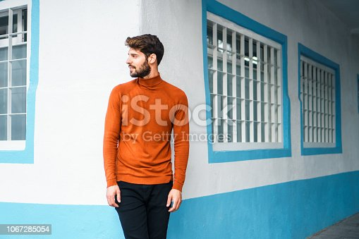 istock Portrait of smiling young man. 1067285054
