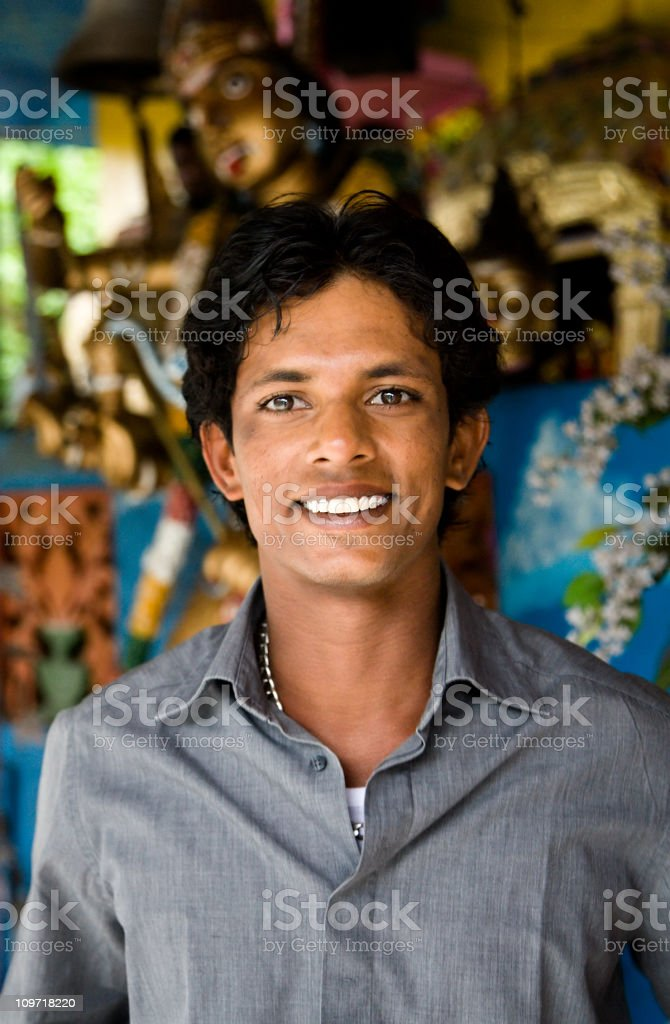 Portrait of smiling Young Sri Lankan Man in Buddhist Temple stock photo