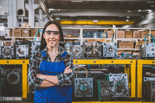 Portrait of trainee mechanic professional young female technical engineer and businesswoman with coverall checking and repairing industry milling machining with tool in a large shipping manufacturing facility warehouse at metal cable factory XXXL
