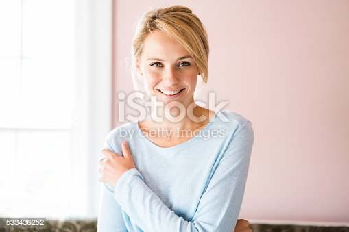 istock Portrait of smiling young woman at home 533436252