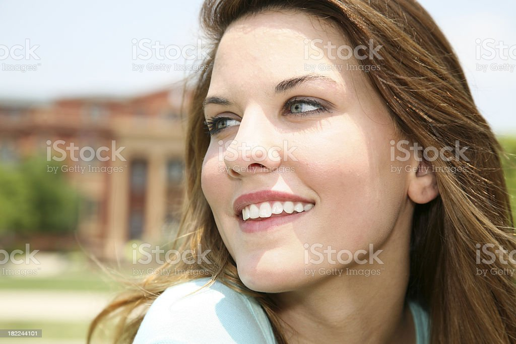 Portrait of Smiling Young Woman on College Campus royalty-free stock photo