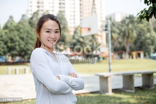 491360572istockphoto Portrait of smiling young woman 1178371505
