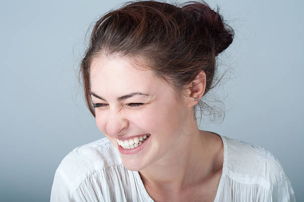 Portrait of smiling young woman with brown hair stock photo