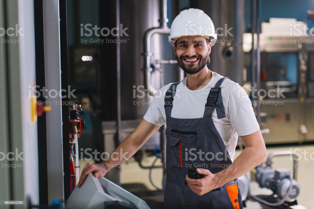 Portrait of smiling young workman on night shift royalty-free stock photo