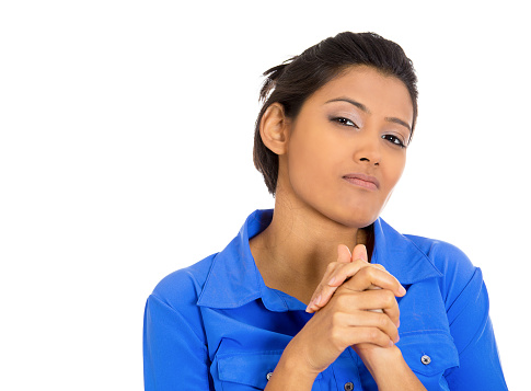 Closeup portrait of sneaky, evil, sly, scheming young woman trying to plot, plan something, screw, hurt someone, isolated on white background. Negative human emotions, facial expressions, feelings