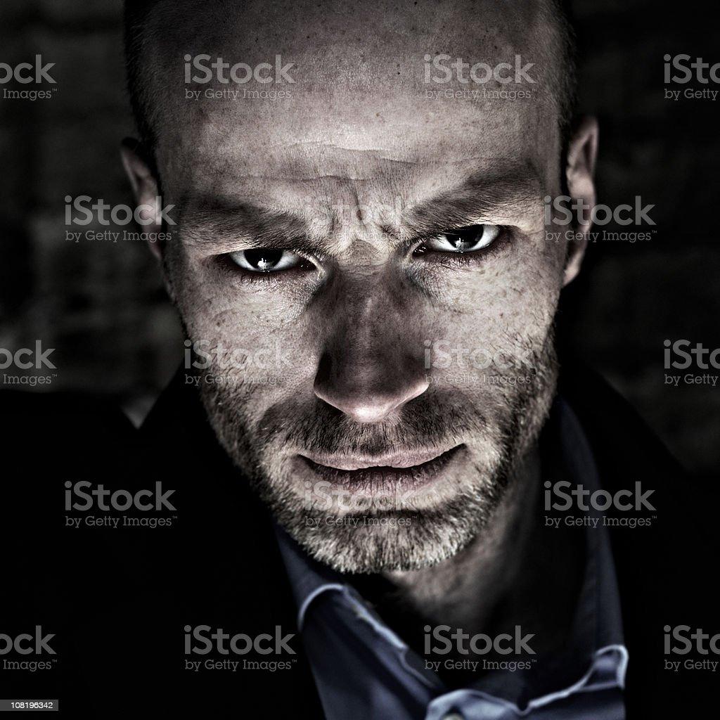 Portrait of Sneering Man, Low Key royalty-free stock photo