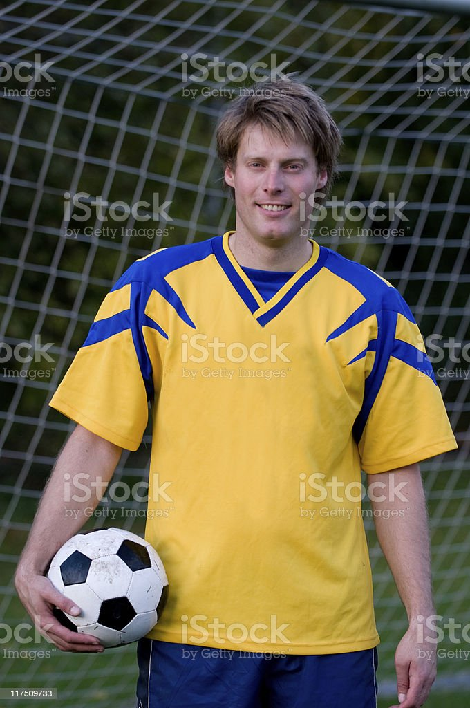 Portrait of soccer player standing in a goal royalty-free stock photo