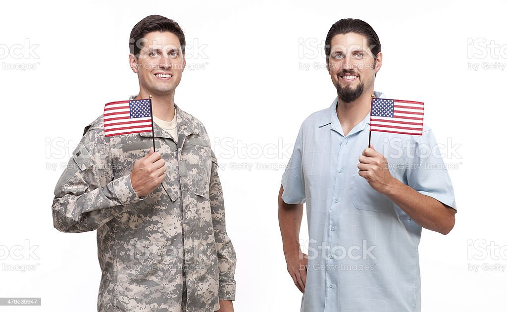 Portrait of soldier and young man holding American flags royalty-free stock photo