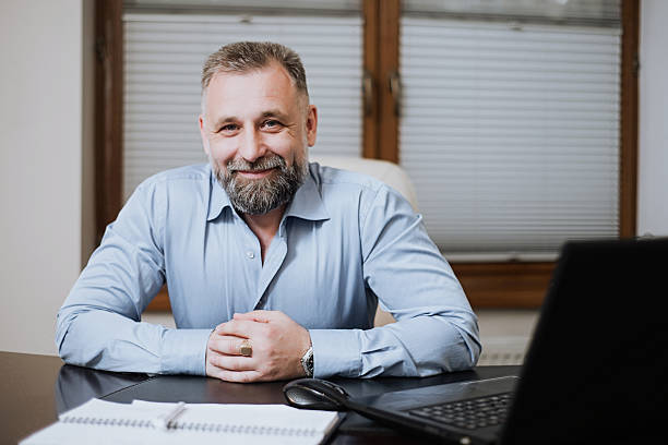 portrait of solid middle-aged businessman. - director stock photos and pictures