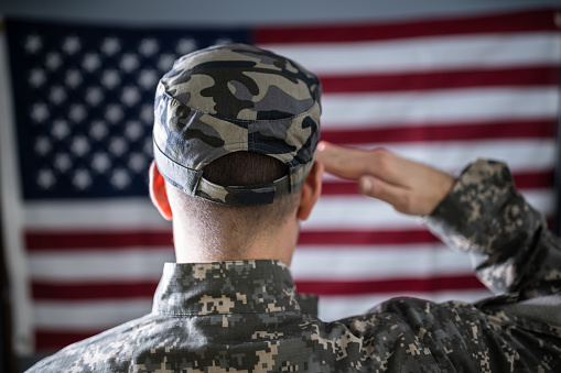 istock Portrait Of Solider Saluting 1191081104