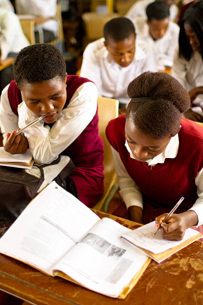 Portrait of South African girls studying in a rural classroom stock photo