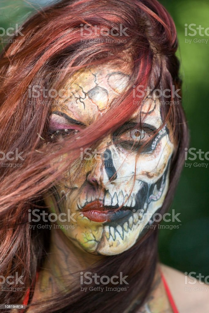 Portrait of Spooky Woman with Skull Face Painting royalty-free stock photo