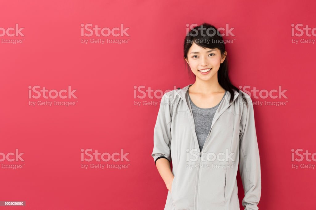 portrait of sporty asian woman isolated on red background - Royalty-free Adult Stock Photo