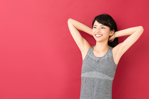 Portrait Of Sporty Asian Woman Isolated On Red Background Stock Photo - Download Image Now