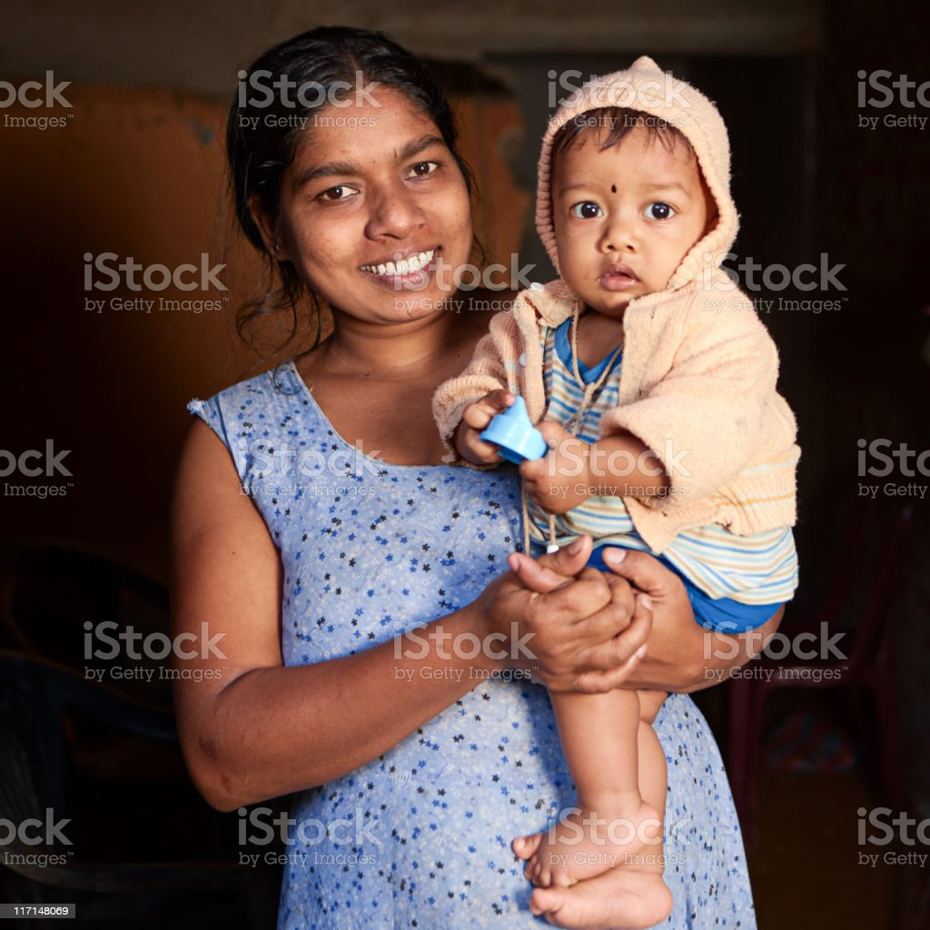 Portrait of Sri Lankan mother with her baby royalty-free stock photo