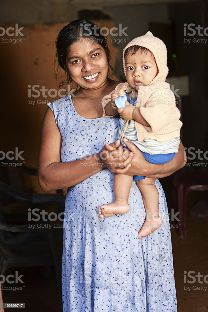 Portrait of Sri Lankan mother with her baby stock photo