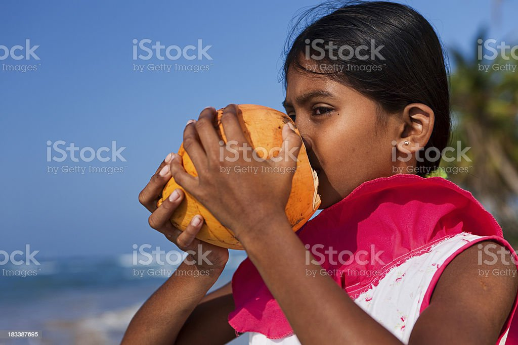 Portrait of Sri Lankan young girl with coconut royalty-free stock photo