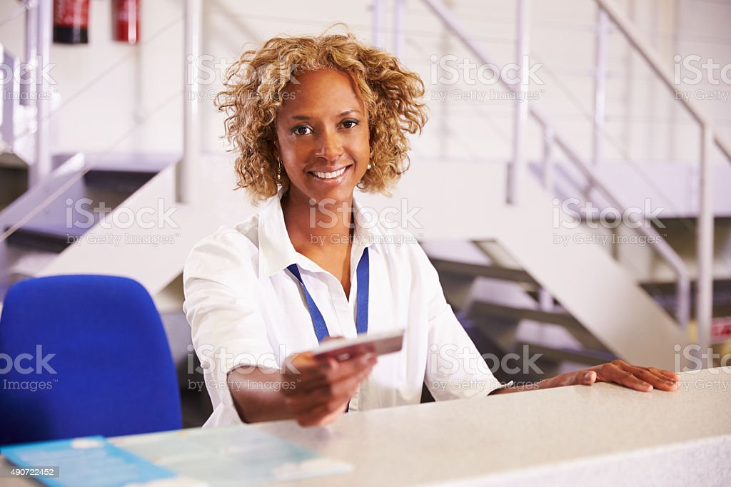 Portrait Of Staff At Airport Check In Desk stock photo