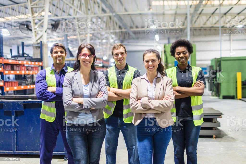 Portrait of staff at distribution warehouse royalty-free stock photo