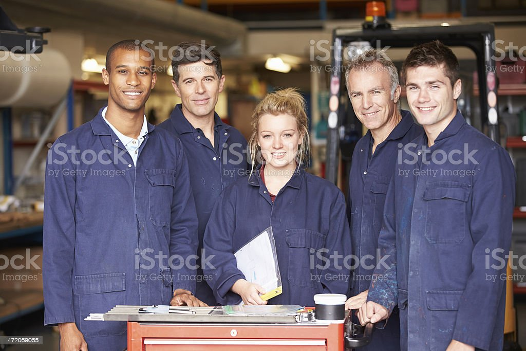 Portrait Of Staff Standing In Engineering Factory stock photo